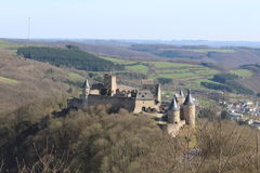 Bourscheid Castle. From a distance under a blue sky early spring Royalty Free Stock Images