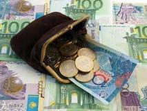 Bourse avec des pièces de monnaie Photos libres de droits
