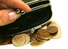 Bourse avec des pièces de monnaie Photo stock