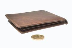 Bourse et pièce de monnaie. Photo stock
