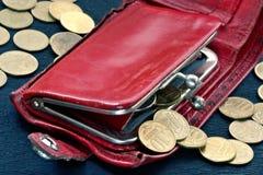 Bourse minable avec des pièces de monnaie Images stock