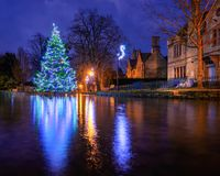 Bourton on the water christmas tree in the river Windrush before sunrise royalty free stock images