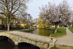 Bourton on the Water Cotswolds UK. This quaint village is known for it's unspoilt limestone cottages in the traditional Cotswold style Royalty Free Stock Photos