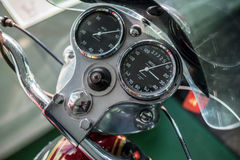 BOURTON-ON-THE-WATER, GLOUCESTERSHIRE/UK - MARCH 24 : Dials on a. Royal Enfield Motorcycle in the Motor Museum at Bourton-on-the-Water in Gloucestershire on Royalty Free Stock Photography