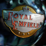 BOURTON-ON-THE-WATER, GLOUCESTERSHIRE/UK - MARCH 24 : Emblem on. A Royal Enfield Motorcycle in the Motor Museum at Bourton-on-the-Water in Gloucestershire on Royalty Free Stock Images