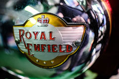 BOURTON-ON-THE-WATER, GLOUCESTERSHIRE/UK - MARCH 24 : Emblem on. A Royal Enfield Motorcycle in the Motor Museum at Bourton-on-the-Water in Gloucestershire on Royalty Free Stock Image