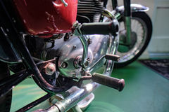 BOURTON-ON-THE-WATER, GLOUCESTERSHIRE/UK - MARCH 24 : Old Royal. Enfield Motorcycle in the Motor Museum at Bourton-on-the-Water in Gloucestershire on March 24 Stock Photos