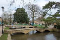 BOURTON-ON-THE-WATER, GLOUCESTERSHIRE/UK - MARCH 24 : Tourists W. Andering around Bourton-on-the-Water in Gloucestershire on March 24, 2017. Unidentified people stock photo