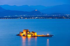 Bourtzi castle in Nafplio. Bourtzi water fortress in Nafplio at night. Nafplio is a seaport town in the Peloponnese peninsula in Greece royalty free stock photography