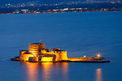 Bourtzi castle in Nafplio. Bourtzi water fortress in Nafplio at night. Nafplio is a seaport town in the Peloponnese peninsula in Greece royalty free stock photo