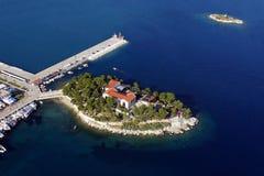 Bourtzi Skiathos aerial. Bourtzi peninsula in Skiathos port, aerial view royalty free stock photo