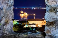 The Bourtzi water castle is a small island with a fortress at the coast of Nafplio. The Bourtzi water castle is a small island with a fortress at the coast of royalty free stock images