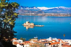 The Bourtzi water castle is a small island with a fortress at the coast of Nafplio in Greece stock photo
