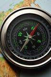 Boussole sur la carte Photographie stock libre de droits