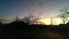 Bout droit de bras de nuages pendant le matin Images stock