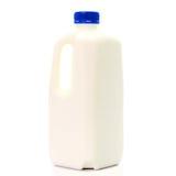 Bouteille à lait avec le chapeau de blud d'isolement sur le fond blanc Images stock