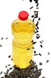 Bouteille avec de l'huile de grains de tournesol Photographie stock libre de droits