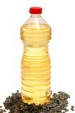 Bouteille avec des graines de pétrole et de tournesol Photo libre de droits