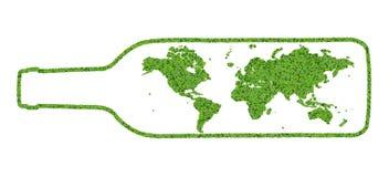 Bouteille avec la terre faite à partir des feuilles vertes Photo libre de droits