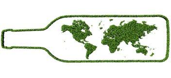 Bouteille avec la terre faite à partir des feuilles vertes Image stock