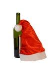 Bouteille avec le chapeau de Santa Image libre de droits