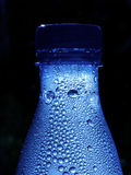 Bouteille bleue Photographie stock libre de droits