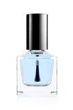 Bouteille bleue de vernis à ongles Photographie stock libre de droits