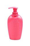 Bouteille cosmétique rose Images stock
