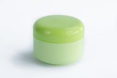 Bouteille crème cosmétique simple de couleur verte jaune Images libres de droits