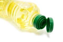 Bouteille d'huile sur le fond blanc Image stock