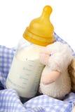 Bouteille de chéri avec du lait images stock