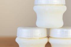 Bouteille de chéri avec du lait Photos stock