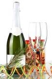 Bouteille de champagne, de glaces et de petit cadeau Photo libre de droits