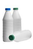 Bouteille de lait avec capuchons colorés Image stock