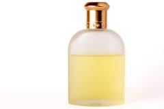 Bouteille de lotion après-rasage de parfum avec le capuchon en métal là-dessus Photos libres de droits