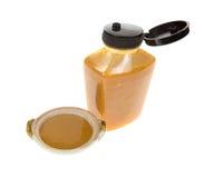 Bouteille de paraboloïde de moutarde de miel Photographie stock libre de droits