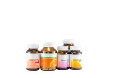 Bouteille de pilule dans d'isolement, verre, coloré, Photographie stock libre de droits