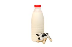 Bouteille de vache à lait et à jouet Photographie stock
