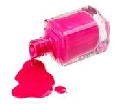 Bouteille de vernis à ongles rose avec des échantillons de baisse Image libre de droits