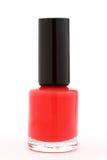 Bouteille de vernis à ongles rouge sur le blanc Photographie stock libre de droits
