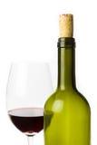 Bouteille de vin vide avec le verre Photographie stock libre de droits