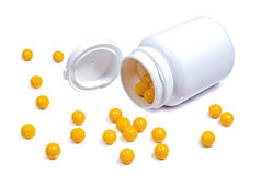 Bouteille en plastique médicale avec les vitamines oranges Photo stock