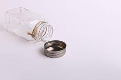 Bouteille en verre assez vide Photographie stock libre de droits