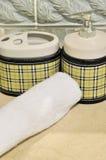 Bouteille et essuie-main de shampooing Image stock