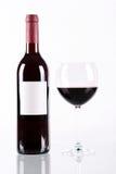 Bouteille et glace de vin rouge Photos libres de droits
