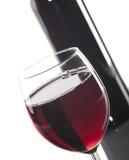 Bouteille et glace de vin rouge Photos stock