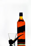 Bouteille, glace et pipe de whisky écossais Photographie stock