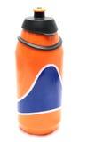 Bouteille orange d'isolement photographie stock