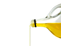 Bouteille pleuvante à torrents d'huile d'olive Photos stock
