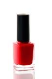 Bouteille rouge de vernis à ongles au-dessus de blanc Image libre de droits